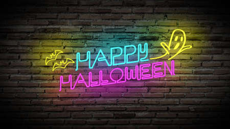 colorful Happy Halloween bright light fluorescent neon sign for party with ghost and bat on retro brick wall background. Stockfoto