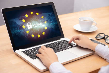 people using computer laptop with text GDPR or General Data Protection Regulation secure , star and padlock logo on monitor screen. cyber security and privacy concept. Stockfoto