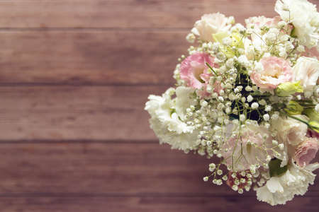 top view of beautiful romantic bouquet fresh spring flower on wooden table background with copy space Stockfoto