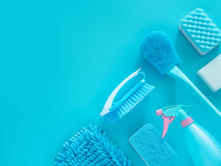 cleaning tools product supplies layout isolated on blue with copy space for template