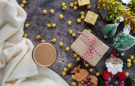 hot coffee in winter season with Christmas background decorations and gift boxes on table