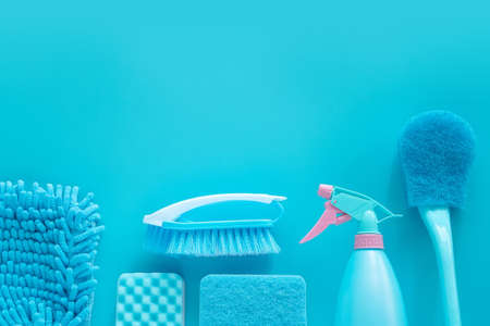 cleaning tools product supplies composition layout isolated on blue with copy space for template