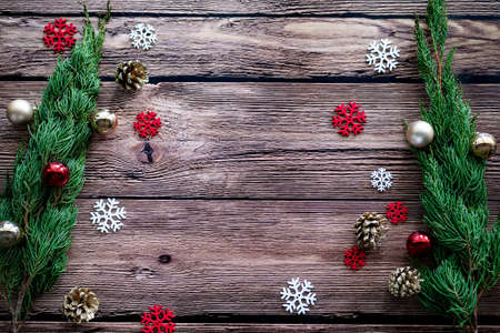 green pine , golden pine cone , snowflakes , Christmas ornaments ball on wooden background with copy space