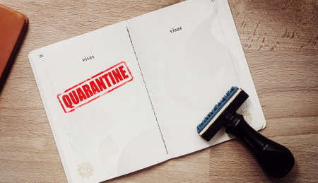 stamp for those who are quarantine in a coronavirus epidemic outbreak situation on passport page for tourist who have a high risk of being infected with a Wuhan virus. 写真素材