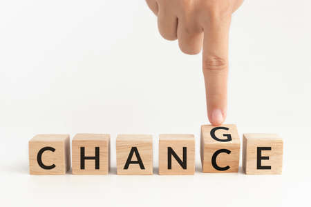 hand flip wooden cube with word change to chance. self improvement, personal development for skills and qualities and career growth or change yourself concept