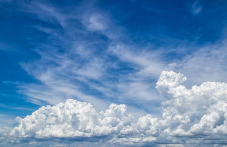 blue sky with white fluffy clouds. beauty nature scene background.