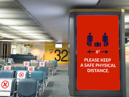 airport board with sign for social distancing around departure gate at airport terminal, sign for warning traveler during travel on epidemic of coronavirus (covid-19) virus situation, new normal Redactioneel