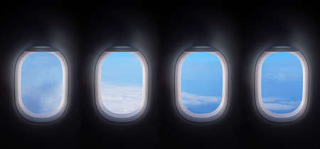 Four airplane windows open white window shutter wide with blue sky view.