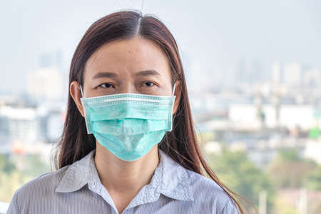 Asian woman wearing hygienic protect face mask to prevent  virus infection while outside home during  virus epidemic transmission to reduce the risk of contracting disease outbreak Stock fotó