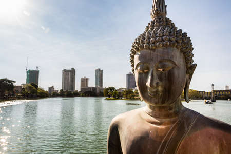 colombo: A statue of Buddha on Beira lake  in Colombo, the capital city of Sri Lanka