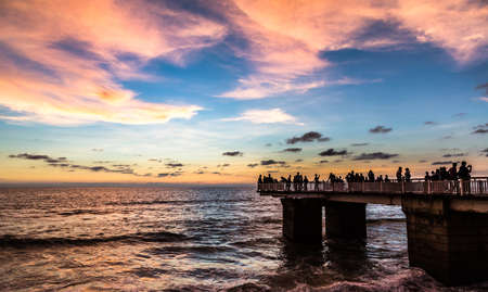 Jetty at sunset along Galle Face Road boarding the Indian ocean in Colombo, Sri Lanka photo