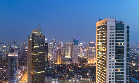 emerging market: Stunning view over Jakarta business district, along the Sudirman avenue, in Indonesia capital city at night. The area around Plaza Indonesia contains a lot of bank HQ and luxury hotels and shopping malls.