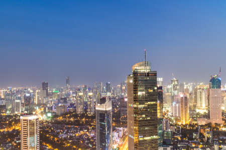 Stunning view over Jakarta business district, along the Sudirman avenue, in Indonesia capital city at night. The area around Plaza Indonesia contains a lot of bank HQ and luxury hotels and shopping malls.