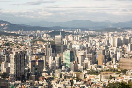 urban sprawl: Office buildings in Seoul, South Korea capital city, viewed from the Namsan mountain in the heart of the city. Seoul is one of the world largest metropolitan area.