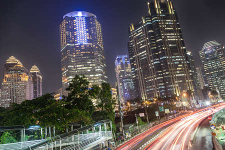 hotel indonesia: Traffic at night in Jakarta, along Indonesia capital city main avenue lined with banks , hotel and luxury shopping malls (Jalan Sudirman) in the business district Editorial