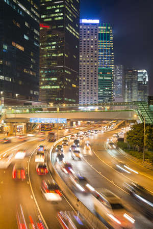 rushes: Traffic rushes through the street of Hong Kong central business district at night