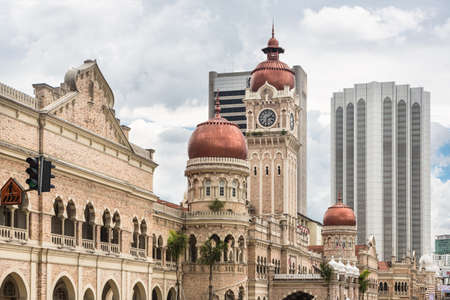 Modern office buildings contrasts with the colonial architecture of the Sultan Abdul Sama building in Kuala Lumpur around Merdeka square in Malaysia capital city.