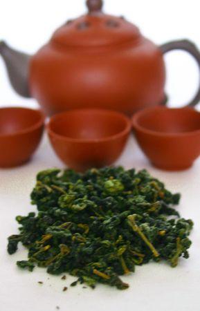Green tea leaves and tea pot