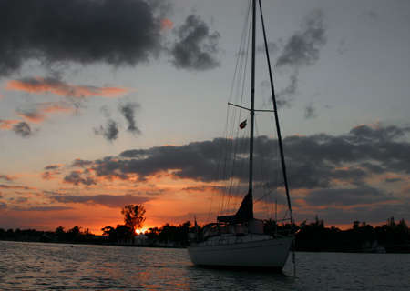 Sailboat against a sunset in Marsh Habor, BS Stok Fotoğraf