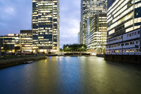 canary wharf: Canary Wharf offices with lights on in the evening Stock Photo