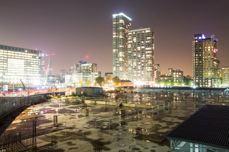 wharf: A night view of a construction site and buildings in Canary Wharf