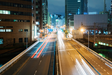 light trails: Downtown Osaka at night with light trails and buildings