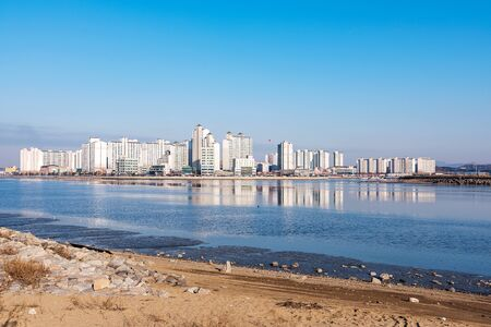 seafronts: apartment buildings with sea and beach on a sunny day in Incheon South Korea Stock Photo