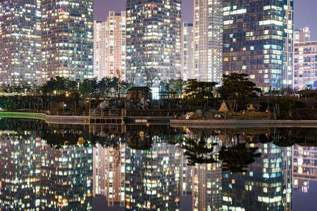 incheon: architecture at night with water reflections in Songdo financial district Incheon South Korea