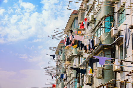 domestic life: chinese apartments with clothes hanging to dry in Shanghai on a sunny day