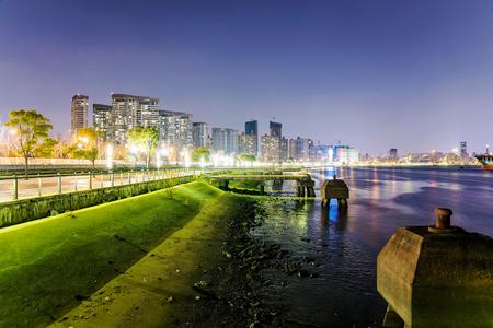 huangpu: view of the west bund and Huangpu river at night in Shanghai China