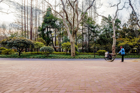 sweeper: Chinese street sweeper in Zhongshan park Stock Photo