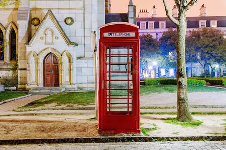 telephone box: English style telephone box at night in Thames Town Shanghai Stock Photo