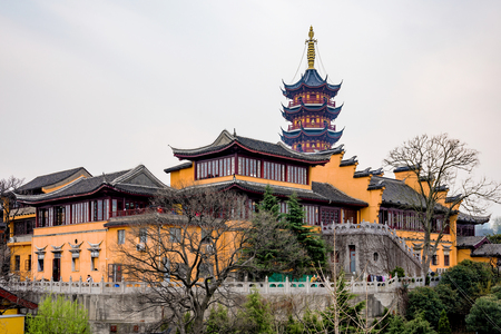 recently: NANJING, CHINA- MARCH 17: Jiming temple is an ancient temple which has recently been restored and now is now a popular tourist site on March 17, 2016 in Nanjing.