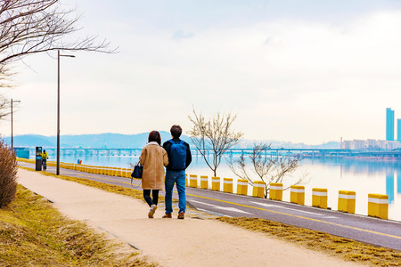 riverside landscape: Romantic riverside landscape with couple walking