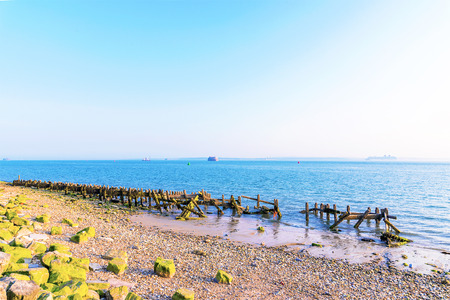 british weather: Portsmouth pebble beach on a sunny day
