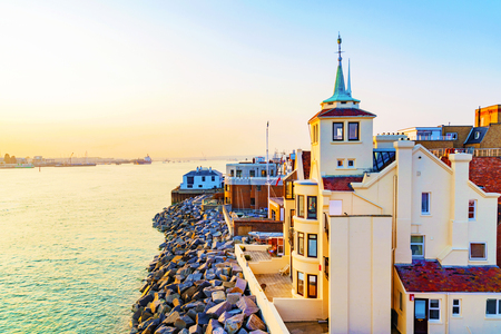Traditional English buildings with sunset and ocean