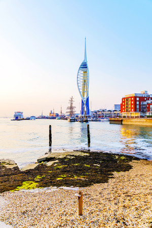 spinnaker: PORTSMOUTH, UNITED KINGDOM - JUNE 06: Portsmouth Emirates Spinaker tower taken from a distance on a pebble beach at sunset on June 06, 2016 in Portsmouth.