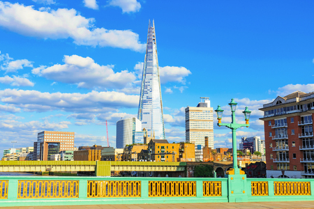 southwark: LONDON - JULY 06, 2016: The shard building is a famous landmark in Londons financial district. This photograph was taken from Southwark bridge which is also a British landmark on July 06, 2016 in London.