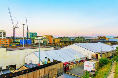 recently: LONDON - JULY 06, 2016: This is a view of Kings Cross station and skyline during sunset. You can see a lot of development happening in this area recently on July 06, 2016 in London.