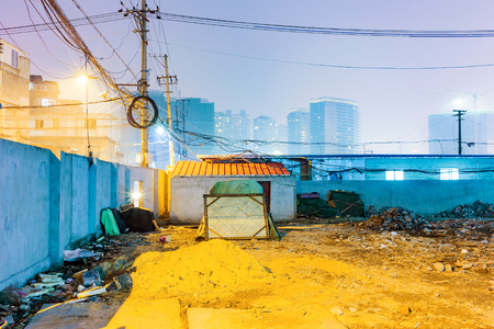 wire mess: Night scene of messy residential area with skyscrapers in the background in Shanghai Stock Photo