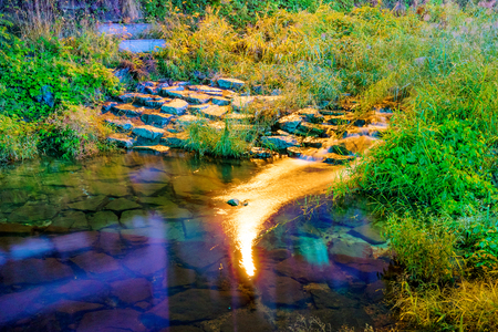 Soft water in a stream at night with rocks Stock Photo