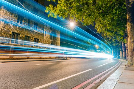 light trails: Night scene of light trails and traditional building Stock Photo