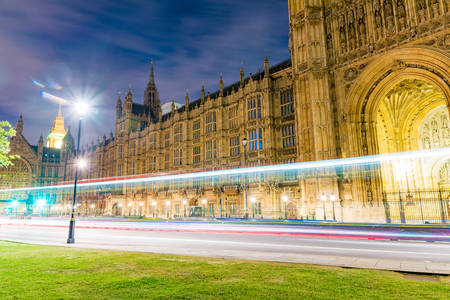 Houses of Parliament at night with ligh trails