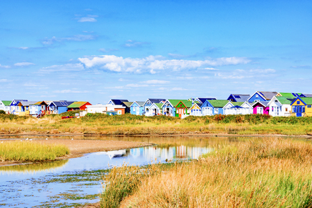 hengistbury: Row of colorful beach huts by the sea