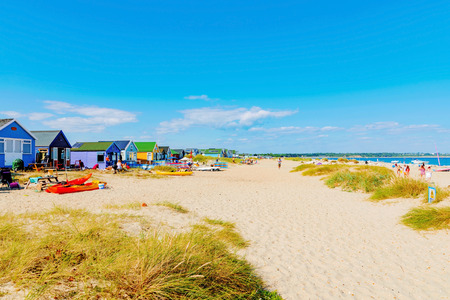 hengistbury head: CHRISTCHURCH, UNITED KINGDOM - AUGUST 22: This is Hengistbury head main beach where people come for vacations, surfing and sailing on August 22, 2016 in Christchurch Editorial
