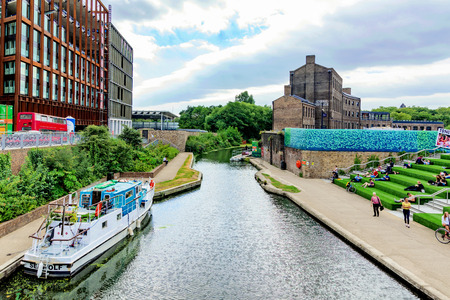 sit around: LONDON - AUGUST 22: The Regents Canal in Kings cross where many University students often sit around on the stairs enjoying the view on August 22nd, 2016 in London