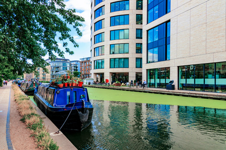 LONDON - AUGUST 22: This is the Regents Canal in Kings Cross where many people go to take walks and some own boathouses on August 22nd, 2016 in London
