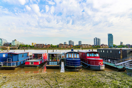 docked: Boats docked along the river thames