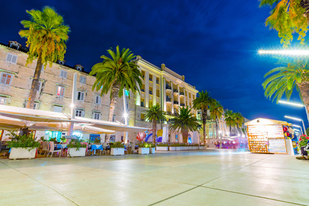 where to eat: SPLIT, CROATIA - SEPTEMBER 17: Old town center promenade in Split at night time with restaurnts where many tourists come to eat Seteptember 17, 2016 in Split