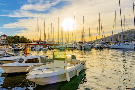 Trogir docks at sunset with boats Stock Photo - 66659759